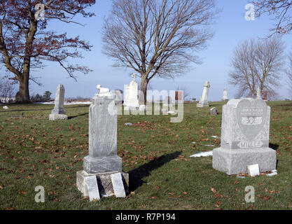 Gravestones at old country cemetery. - Stock Image