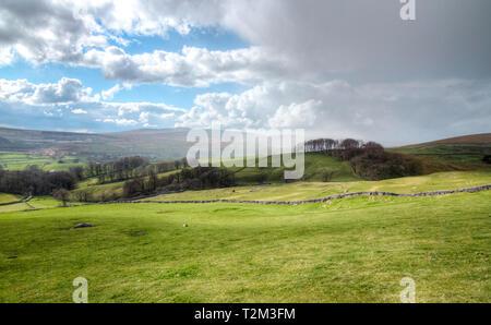 Rain clouds move in over farmland in the Peak District, England. - Stock Image