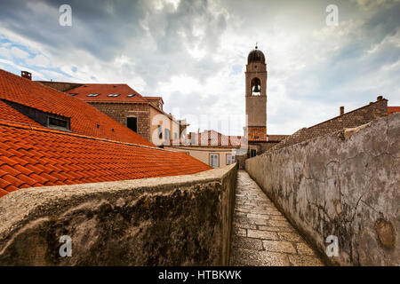 City walls and tower of the Franciscan Monastery; Dubrovnik, Croatia - Stock Image