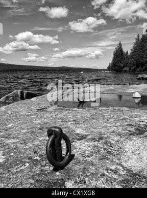 Flat rock and old boat cleat Lake Avril, Vermont,USA - Stock Image