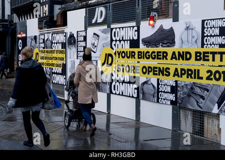 People walking past the JD Sports store in Chester city centre which is closed for refurbishment - Stock Image
