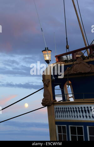 Port side of a tall ship with shining moon. - Stock Image