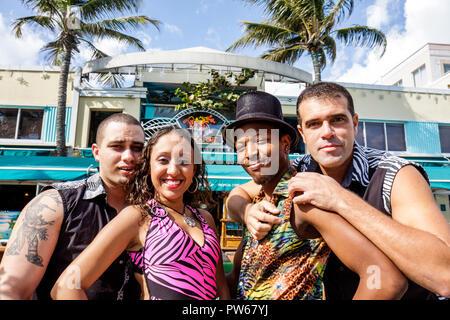Miami Beach Florida Ocean Drive New Year's Day Art Deco District Mango's Cafe Black Hispanic man men woman dancers entertainer - Stock Image