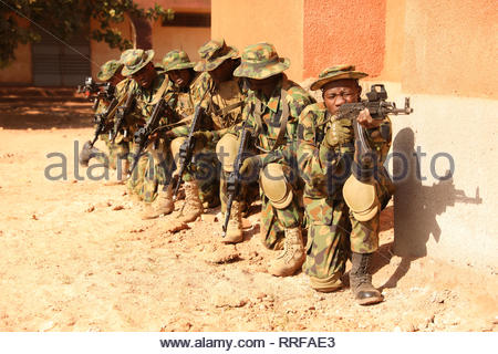 Nigerian soldiers stack in line prior to entering a building for a training exercise during Flintlock 2019 February 22, 2019 in Bobo-Dioulasso, Burkina Faso. Flintlock is a multi-national exercise consisting of 32 African and Western nations at multiple locations in Burkina Faso and Mauritania. - Stock Image