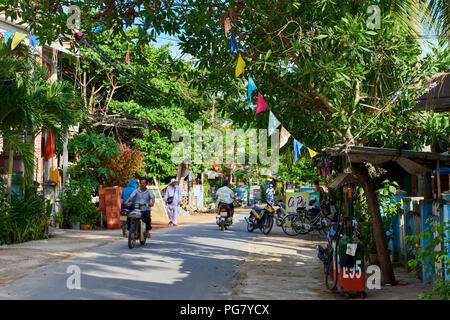 A quiet street in the coastal town of An Bang, Central Vietnam. The town is situated near the UNESCO protected town of Hoi An. - Stock Image