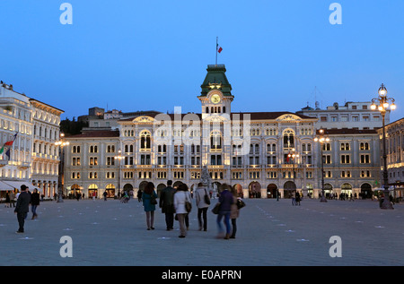 Trieste, Italy. People on Unity square (Piazza Unita) at night. - Stock Image
