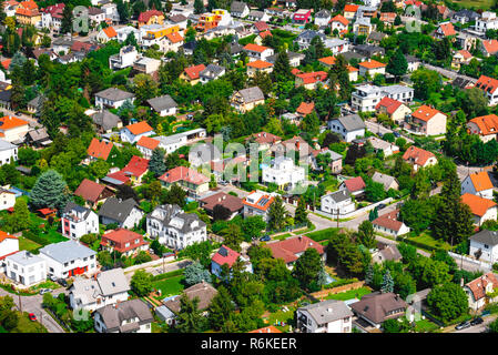 Residential neighborhood with green yards and outdoor facilities - Stock Image