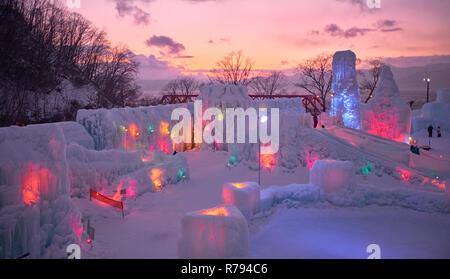 Lake Shikotsu Ice Festival,an ice sculpture event held in Lake Shikotsu hot springs in Shikotsu-Toya Park with lights illuminating ice sculptures - Stock Image