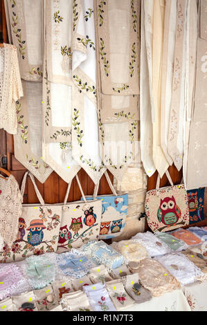 Traditional lacework and embroidery outside souvenir shop, Omodos (Troodos Mountains), Limassol District, Republic of Cyprus - Stock Image