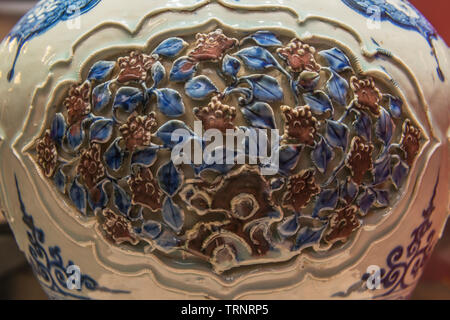 Part of Blue and White Underglaze Red Jar with Hallowed-out Lid. 1271 AD - 1368 AD(Yuan Dynasty).  Hebei Museum, China - Stock Image