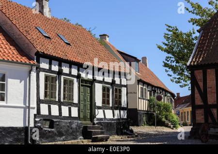 Quaint old houses on narrow cobbled street of Overgade, Ebeltoft, Jutland, Denmark, Scandinavia - Stock Image