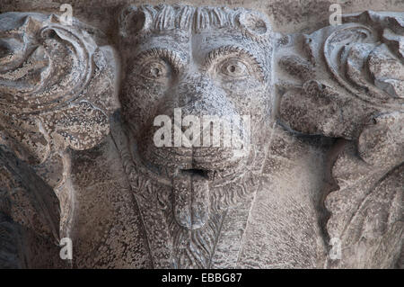 Detail of carving of lion on capitol of pillars of upper corridor of Doges Palace or Palazzo Reale in Venice Italy - Stock Image