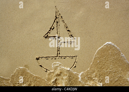 Drawing of a sail boat wet sand, about to be washed away. Please see my collection for more similar photos. - Stock Image
