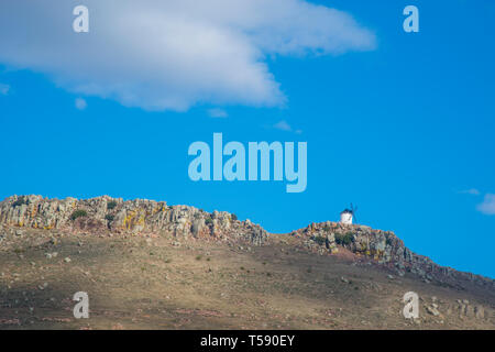 Windmill on top of a hill. Fuente El Fresno, Ciudad Real province, Castilla La Mancha, Spain. - Stock Image