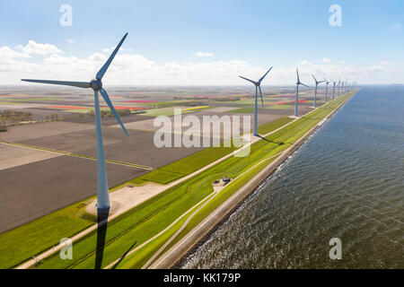Aerial view of wind turbines by the sea, North Holland, Netherlands - Stock Image