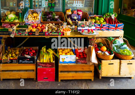 An attractive display of winter fruit and vegetables with 2019 price tickets in a greengrocer's shop in North Yorkshire - Stock Image