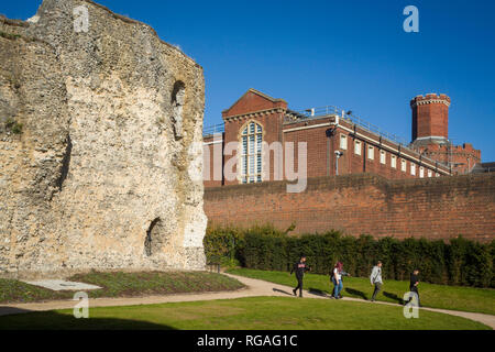 The main Victorian building of Reading Prison viewed from newly restored ruins of Reading Abbey, Berkshire - Stock Image