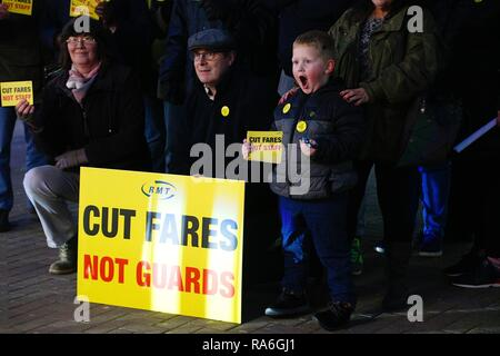 Hastings, East Sussex, UK. 2nd Jan, 2019. A peaceful protest is taking place outside Hastings train station in solidarity with other protests nationwide regarding the 3.1% increase in fares. Members of the RMT union stand outside the station. Credit: Paul Lawrenson/ Alamy live news - Stock Image