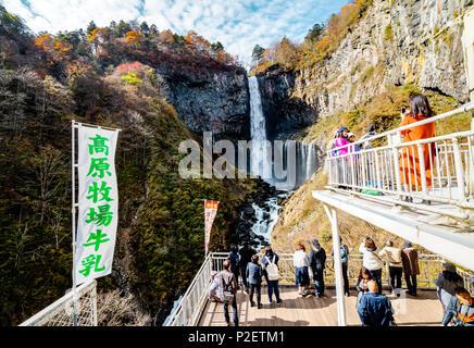 Tourists taking photo of Nikko Kegon Falls from viewpoint in Nikko, Tochigi Prefecture, Japan - Stock Image