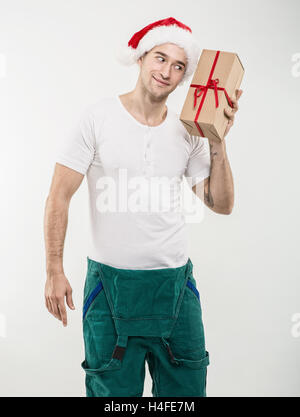 Courier - In the hands of boxes, gift - Stock Image