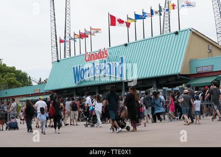 visitors lineup in at the entrace of canada's wonderland, the biggest amusement park in canada - Stock Image