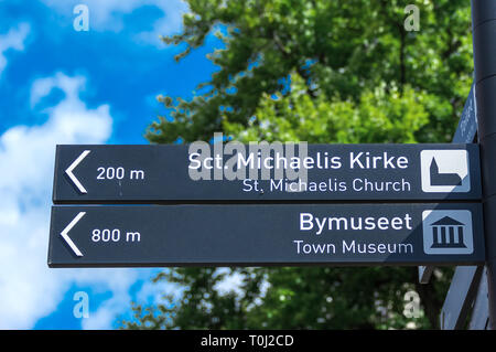 Information signpost giving information about the directions to tourist attractions- Fredericia, Denmark. - Stock Image
