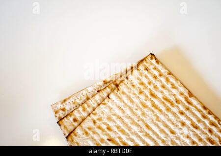 Jewish traditional Matso unleavened bread, matso bread is made during the Jewish Passover Pesach holiday. Pesach concept greeting card. - Stock Image
