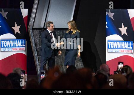U.S First Lady Melania Trump shakes hands with panel moderator Eric Bolling, during an Opioid Town Hall at the Westgate Las Vegas Resort and Casino March 5, 2019 in Las Vegas, Nevada. - Stock Image