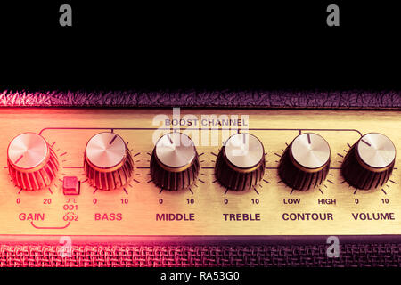 vintage amplifier six knobs horizontal closeup, copy space on top, red corner, isolated - Stock Image