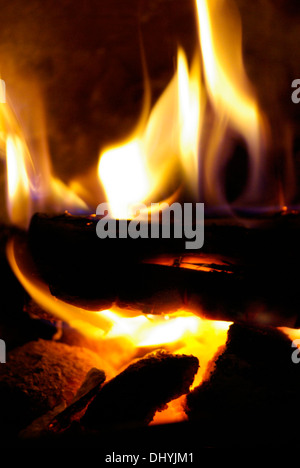 Close-up of open fire with logs burning. - Stock Image