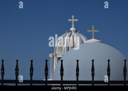 Blue domed bell towers outside Firastephanis on the Greek Island of Santorini show Venetian legacy. - Stock Image