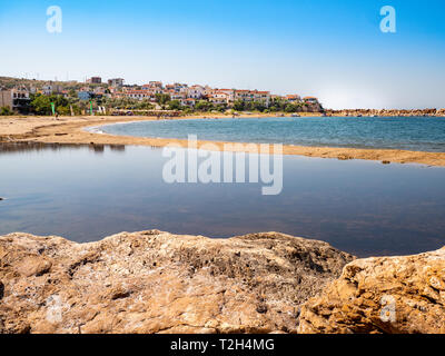 Platanes beach and Skala Marion traditional greek town in Thassos, Greece - Stock Image
