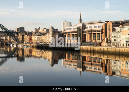 Newcastle Crown court and other quayside buildings reflected in the river Tyne, north east England, UK - Stock Image
