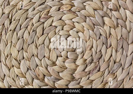 Close up of woven water hyacinth place mat texture - Stock Image