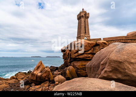 Perros-Guirec, France - July 30, 2018: Ploumanac'h lighthouse against sky - Stock Image