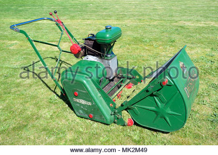 A vintage petrol engine 24 inch cutter Dennis lawn mower. - Stock Image