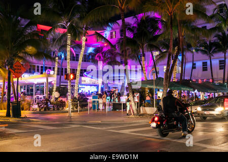 Colorful lighting of the Clevelander Hotel and Nightclub outdoor patio bar on Deco Drive in South Beach Miami, Florida, - Stock Image