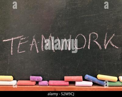 Teamwork written on a chalkboard - Stock Image