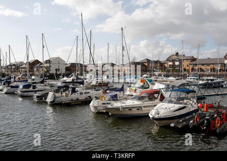 Speedboats and sailing yachts moored in Penarth Marina Wales UK - Stock Image