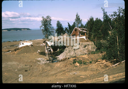 Strong earth movement and toppled-down houses as a result of earthquake of March 27th 1964; near Anchorage, Alaska. - Stock Image