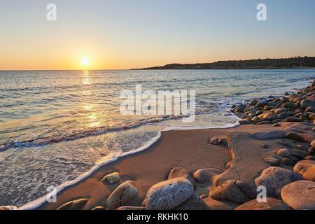 Stony beach, Beach at sunset, Agia, Thessaly, Crete, Greece - Stock Image
