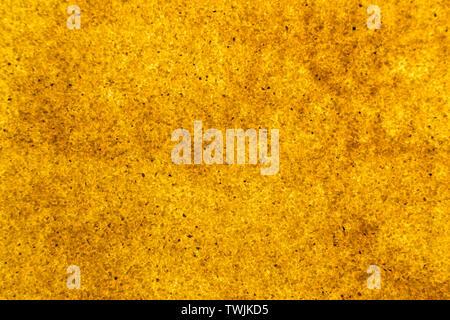 bright background of golden sand granules. backlit background - Stock Image
