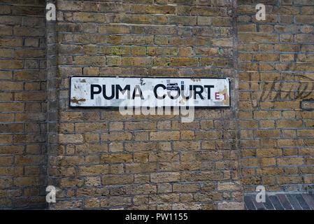 Puma Court street name plate on brick wall, east London, England, UK - Stock Image
