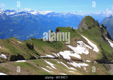 Brienzer Rothorn steam train short before reaching the summit station. - Stock Image
