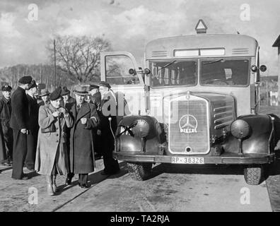 A shuttle bus of the Reichspost (Mercedes-Benz O2600) in front of the Berlin-Rangsdorf airport. - Stock Image