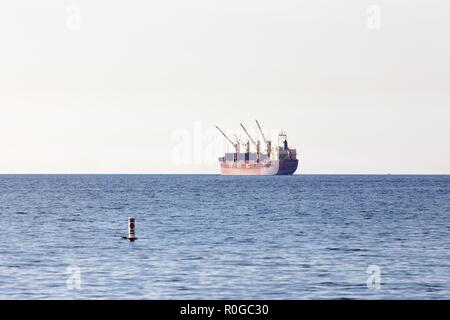 Cargo Freight Ship Nautical Vessel in Burrard Strait waiting entrance to Vancouver BC Canada Commercial Port - Stock Image