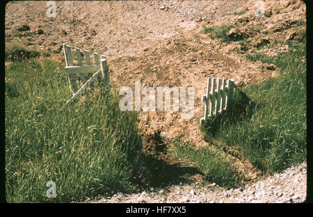 Offset of a fence due to earth movement. Result of earthquake of March 27th, 1964; near Anchorage, Alaska. - Stock Image