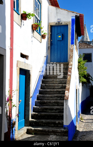 Street scene showing staircase in the medieval town of Obidos some 50 miles north of Lisbon, Portugal - Stock Image