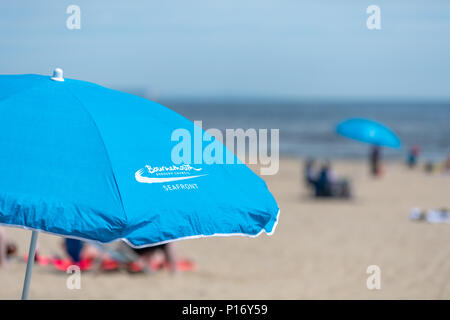 Bournemouth, UK. 11th June 2018. Beach parasol on Bournemouth beach and seafront. Credit: Thomas Faull/Alamy Live News - Stock Image