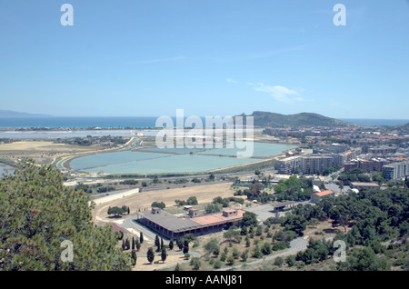 Cagliari Salt Flats and the  Devil s Saddle Sardinia   flat salt pan shallow lagoon Devil s Saddle Sella del Diavolo landscape - Stock Image